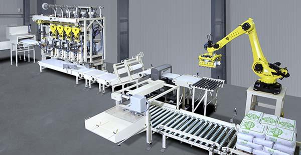 Komplettlösung mit acht aneinander gereihten Luftpackern und dem Palettierroboter Velopack