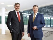 Im Bild zu sehen: Peter Ottmann und Dr. Roland Fleck; Geschäftsführer Nürnberg Messe